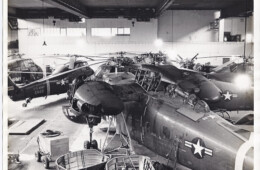 Helicopter maintenance work being done in a hanger at the Flugplatz